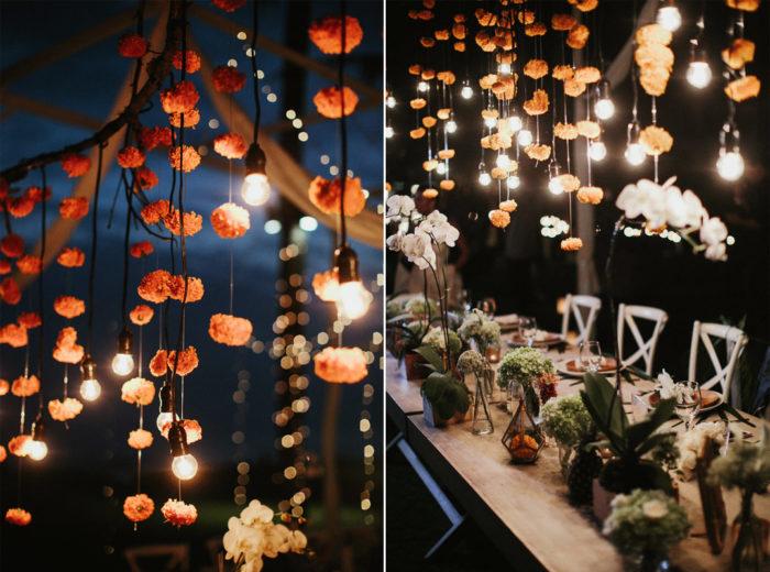 Blomster- och ljusslingedekorationer för bröllopet.