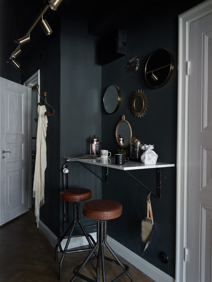 Dark painted walls, mirror wall and spotlights. Scandinavian interior decoration ideas and inspiration.