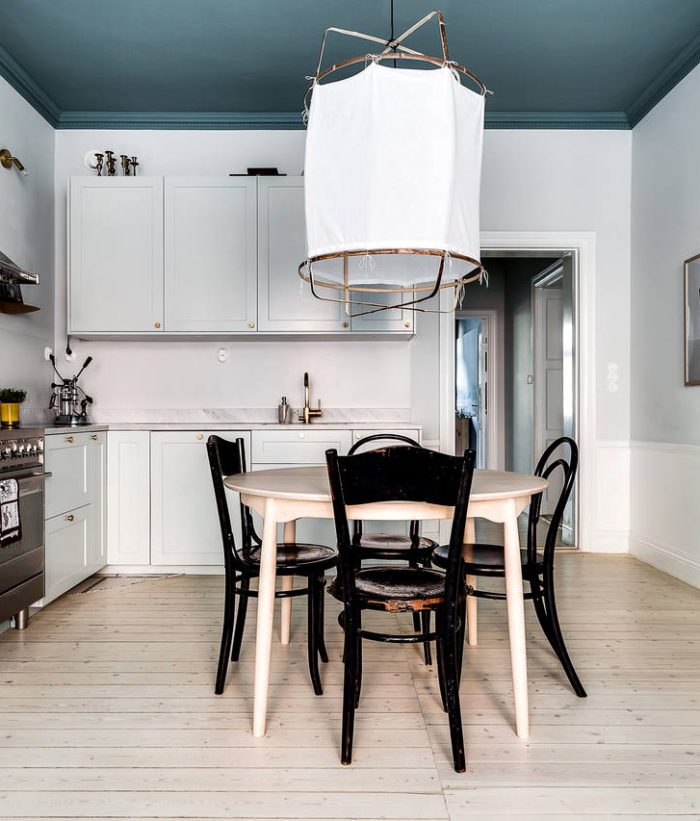 Blue painted ceiling in an apartment in Stockholm. Scandinavian styled kitchen.