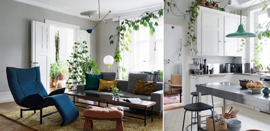 Stilsäker sekelskiftesvåning med en oas av växter